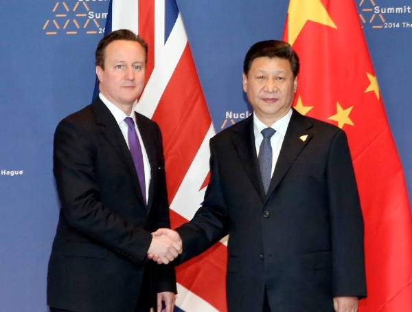 File photo of Chinese President Xi Jinping (R) meets with British Prime Minister David Cameron in The Hague, the Netherlands, March 25, 2014 [Xinhua]