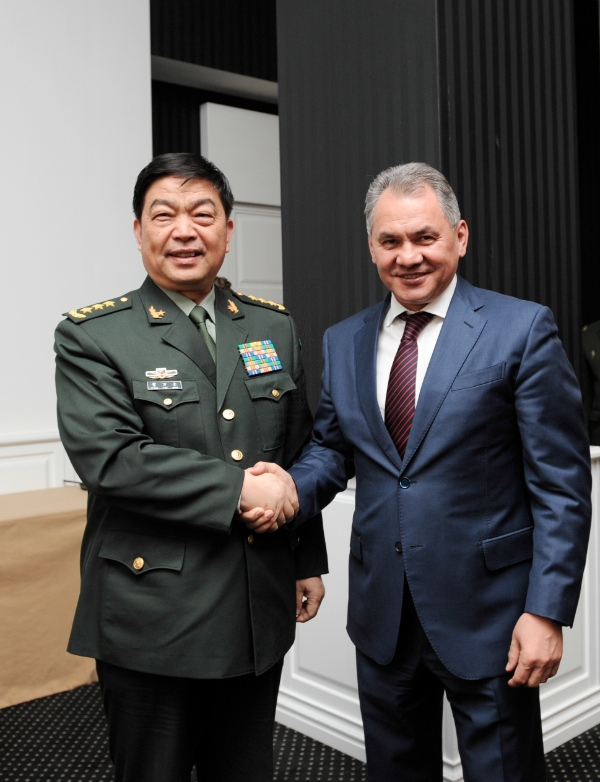 Chinese State Councilor and Defense Minister Chang Wanquan (L) meets with  Russian Defence Minister Sergei Shoigu in Moscow, Russia, on April 16, 2015 [Xinhua]