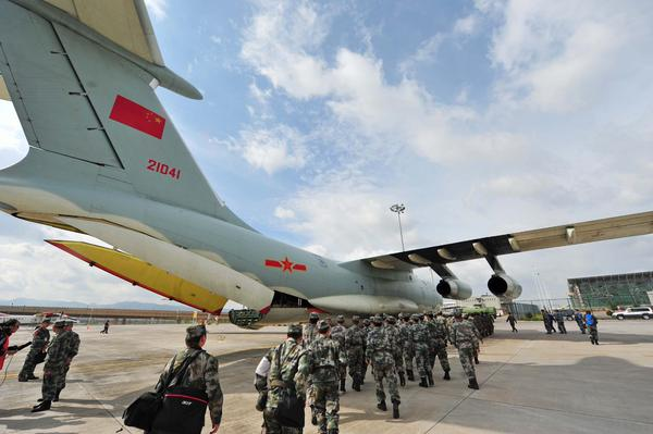 A PLA Air Force plane, departed from Kunming, capital of southwest China's Yunnan Province with a 55-member team on 27 April 2015 [Xinhua]