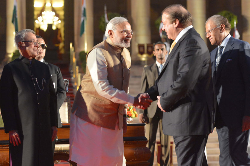 Indian Prime Minister Narendra Modi with his Pakistani counterpart Nawaz Sharif in New Delhi on May 26, 2014 [Xinhua]