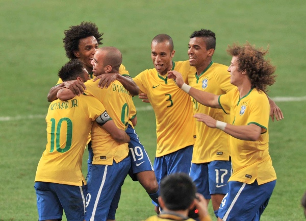 Team Brazil celebrate a goal during a friendly match against Argentina in Beijing, capital of China, Oct. 11, 2014 [Xinhua]
