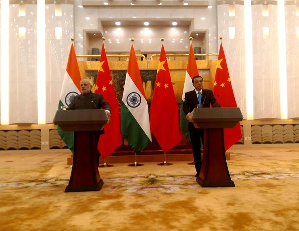 Chinese Premier Li Keqiang with his Indian counterpart Narendra Modi addressing the press following talks in the Great Hall of the People in Beijing on 15 May 2015 [Xinhua]