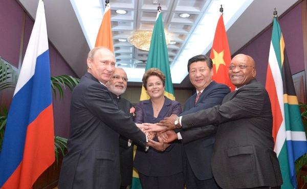 As the BRICS countries prepare to launch new financial institutions like the $100 billion BRICS Bank, the China-led Asia Infrastructure Investment Bank, and a $100 billion BRICS currency reserve fund, the IMF has once again delayed voting reforms to give emerging countries greater say [Xinhua]