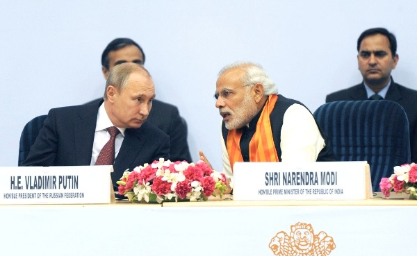 Prime Minister Narendra Modi, seen here with Russian President Vladimir Putin in 2014, has traveled to 40 countries to boost India's trade ties [PPIO]