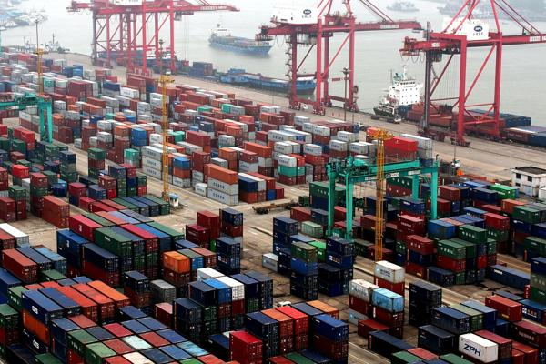 File photo shows cargo containers at a Shanghai port in 2014 [Xinhua]