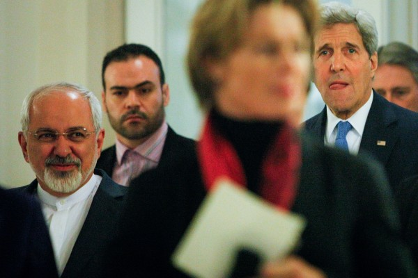 File photo of Iranian FM Javad Zarif, left, and Kerry, who had previously avoided discussing Syria during the nuclear talks. But US officials say Washington must engage Iran on the issue [Xinhua]