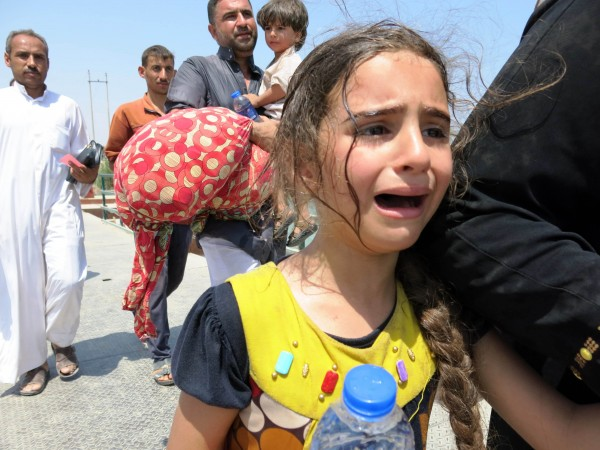Tens of thousands of Iraqi civilians who fled fighting in Anbar province are now at extreme risk due to a scorching heat wave in the region, doctors warn [Xinhua]