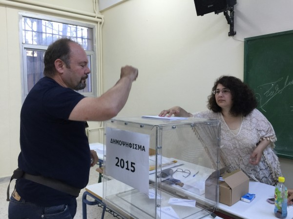 A voter casts his ballot at a polling station in Athens. Polls opened at 7am throughout the country [Xinhua]