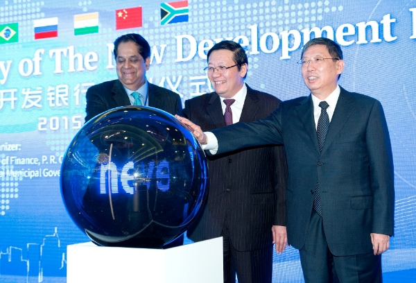 Chinese Finance Minister Lou Jiwei (C), Shanghai Mayor Yang Xiong (R) and President of the New Development Bank (NDB) of BRICS K.V. Kamath attend the launching ceremony of the bank in Shanghai, east China, July 21, 2015 [Xinhua]