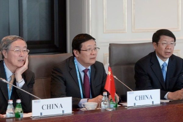 Minister of Finance of the People's Republic of China Lou Jiwei, center, and Governor of the People's Bank of China Zhou Xiaochuan, left, at the BRICS Finance Ministers and Central Bank Governors' Meeting, Meeting of the Board of Governors of the BRICS New Development Bank [Image: BRICS2015.ru]