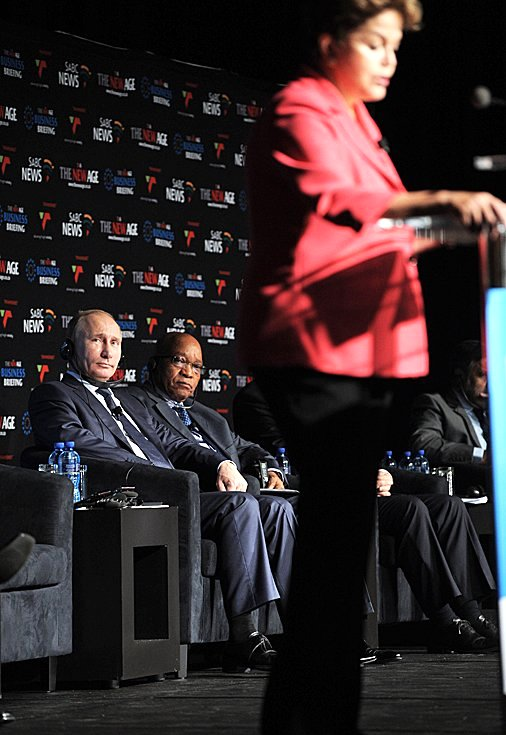 Brazilian President Dilma Rousseff delivers an address at the 5th BRICS Summit, 2013, in Durban, South Africa  while Russian President Vladimir Putin and South African President Jacob Zuma look on [PPIO]