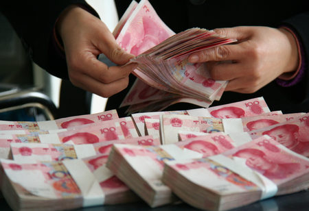 The Chinese currency reached a record high market share of 2.79 per cent in global payments for the month [Xinhua]