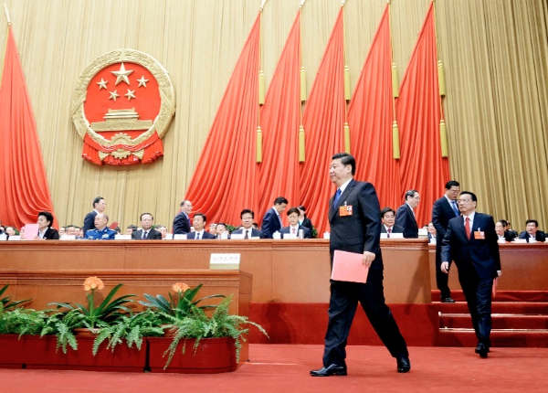 File Photo: Xi Jinping and Li Keqiang walk to cast their votes at the fifth plenary meeting of the first session of the 12th National People's Congress (NPC) at the Great Hall of the People in Beijing, capital of China, March 15, 2013 [Xinhua]