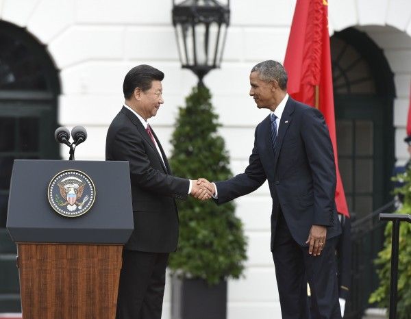 Obama and Xi, sometimes sparring partners, agreed to work together to end cyber crimes and espionage during a press conference at the White House [Xinhua]
