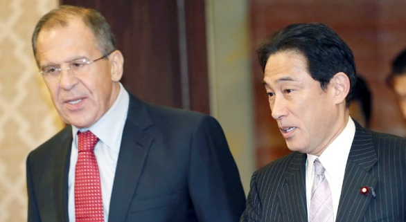 Japan's Foreign Minister Fumio Kishida (right) with Russian Foreign Minister Sergey Lavrov [Xinhua]