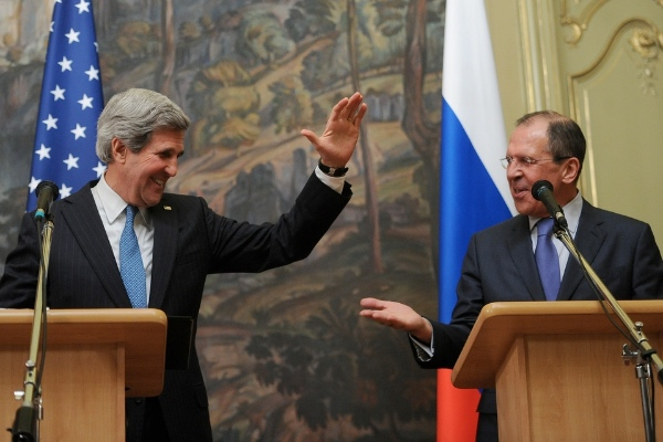File Photo: US Secretary of State John Kerry with Russian Foreign Minister Sergey Lavrov [Xinhua]