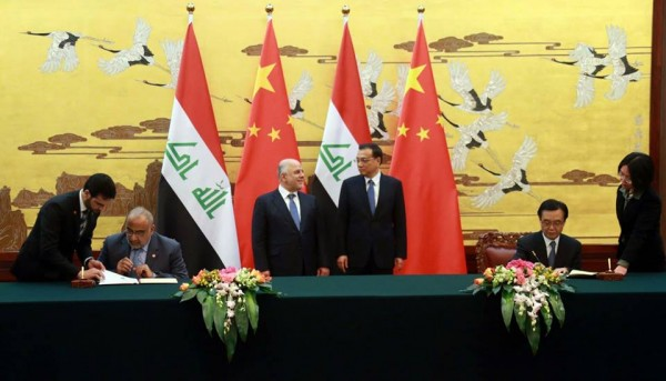 Chinese Premier Li Keqiang and his Iraqi counterpart Haider Al-Abadi witness the signing of 5 agreements in Beijing on 22 December 2015 [Xinhua]