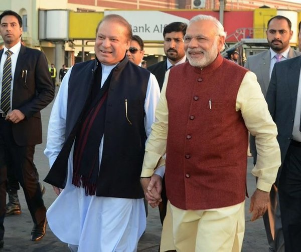 In a rare show of friendship India Prime Minister Narendra Modi (right) with his Pakistani counterpart Nawaz Sharif in Lahore, Pakistan on 25 December [Xinhua]