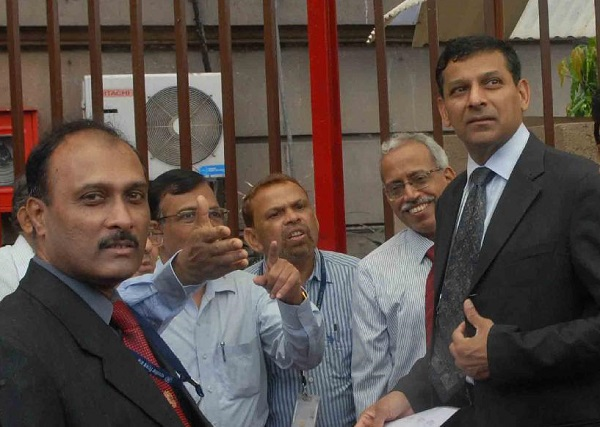 File Photo: India Central Bank Chief Raghuram Rajan (1st R), at the Reserve Bank of India headquarters in Mumbai, India [Xinhua]