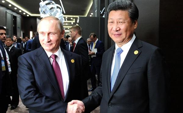 Presidents Xi Jinping, Vladimir Putin meet on the sidelines of the G20 summit in Antalya, Turkey on 15 November 2015 [PPIO]