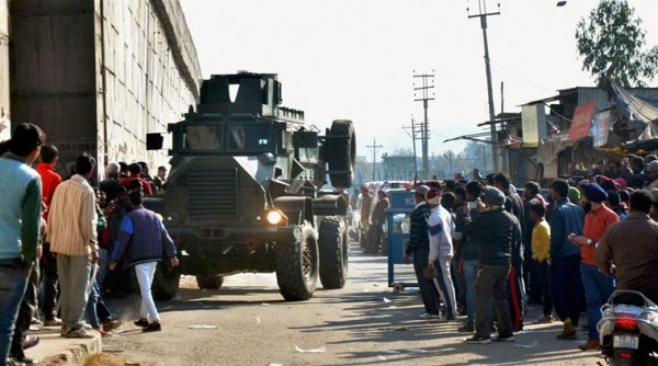 An armored vehicle moves near the Indian Air Force base that was attacked by militants in Pathankot, Punjab, India on 2nd January 2015 [PTI]