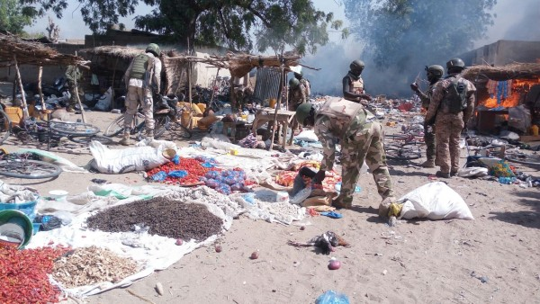 Nigerian soldiers inspect a Boko Haram camp in northeastern Borno state after it was seized amid heavy fighting. The Nigerian president has vowed to destroy Boko Haram this year [Xinhua]