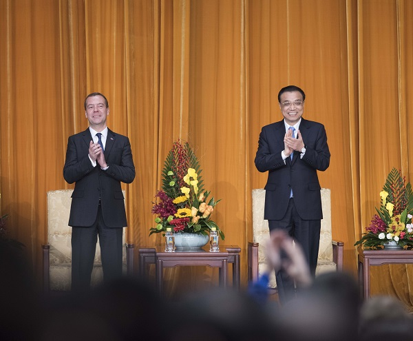 File photo:  Chinese Premier Li Keqiang (R) and Russian Prime Minister Dmitry Medvedev attend the closing ceremony of China-Russia Youth Year & opening ceremony of China-Russia Media Exchange Year in Beijing, capital of China, Dec. 17, 2015 [Xinhua]
