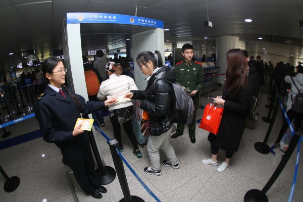 Medical staff pass out information about the Zika virus at Qingdao Airport in eastern China. The government has ordered the cleaning of public areas such as bus stations and markets to destroy the breeding grounds for the mosquito which carries the virus [Xinhua]