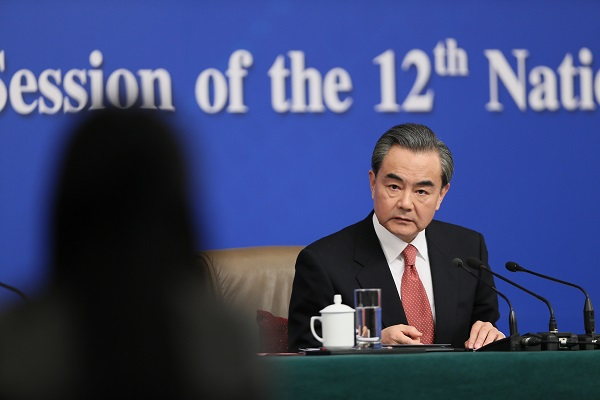 Chinese Foreign Minister Wang Yi listens to questions from a journalist at a press conference on the sidelines of the fourth session of China's 12th National People's Congress in Beijing, capital of China, March 8, 2016 [Xinhua]