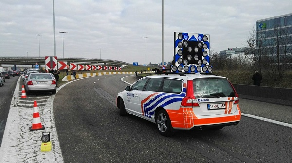 A police car blocks the road to Brussels Internatinal Airport in Brussels, Belgium, on March 22, 2016 [Xinhua]
