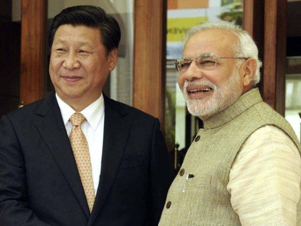 File photo: Chinese President Xi Jinping with Indian Prime Minister Narendra Modi [[Xinhua]