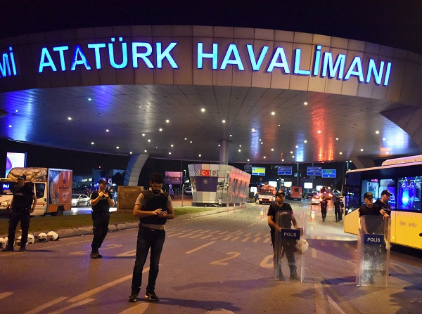 Policemen stand guard at the entrance to Ataturk International Airport in Istanbul, Turkey, June 29, 2016 [Xinhua]