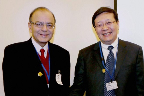 File photo: Indian Finance Minister Arun Jaitley and his Chinese counterpart Lou Jiwei [Xinhua]