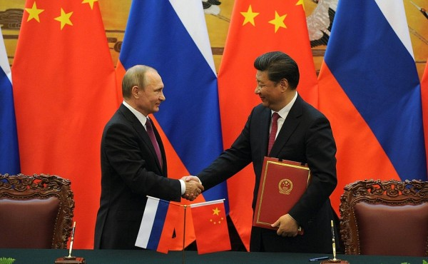 Putin and Xi witnessed signing of deals following talks in Beijing on 25 June 2016 [Image: PPIO]