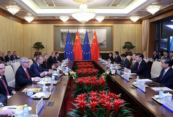 Chinese PresidentXi Jinping(2nd R, front) meets with European Council President Donald Tusk (3rd L, front) and European Commission President Jean-Claude Juncker (2nd L, front) in Beijing, capital of China, July 12, 2016 [Xinhua]
