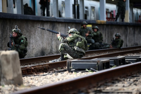 Members of the armed forces engage in a counter-terrorism drill in Rio as Brazil beefs up its security measures ahead of the Olympic Games [Xinhua]