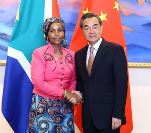 Nkoana-Mashabane, seen here with Chinese Foreign Minister Wang Yi, says a multilateral approach should not be imposed for finding a lasting solution to a bilateral issue [Xinhua]