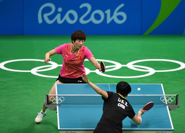 China's Ding Ning returns the ball against her compatriot Li Xiaoxia during the women's singles gold medal match of table tennis at the 2016 Rio Olympic Games in Rio de Janeiro, Brazil, on Aug. 10, 2016 [Xinhua]