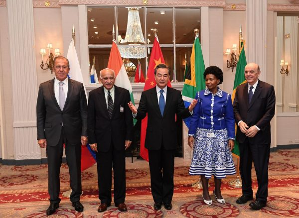 (160921) -- NEW YORK, Sept. 21, 2016 (Xinhua) -- (From L to R) Russian Foreign Minister Sergey Lavrov, Indian Minister of State for External Affairs M.J. Akbar, Chinese Foreign Minister Wang Yi, South African Foreign Minister Maite Nkoana-Mashabane and Brazilian Foreign Minister Jose Serra pose for a group photograph during a meeting of foreign ministers from the BRICS nations on the sidelines of a series of UN conferences in New York [Xinhua]