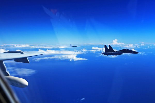 A Su-30 fighter and an H-6K bomber of the Chinese Air Force take part in the drill in the East China Sea Air Defense Identification Zone (ADIZ) [Xinhua]