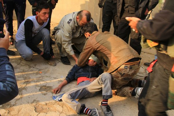 An Iraqi boy is being treated by Iraqi forces after being hit by retreating ISIL forces who have lost 70 per cent of eastern Mosul [Xinhua]